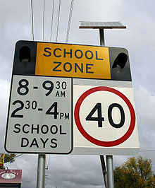 220px-School_zone_flashing_light_warning_sign
